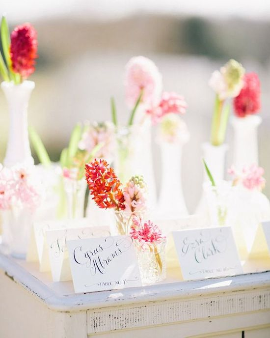 Pretty Escort Card Table Filled With Flowers