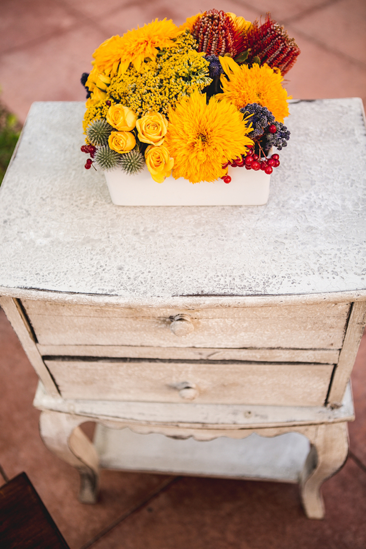Yellow shabby chic furniture - Shabby Chic Furniture With A Golden Yellow And Rustic Red Flower Arrangement