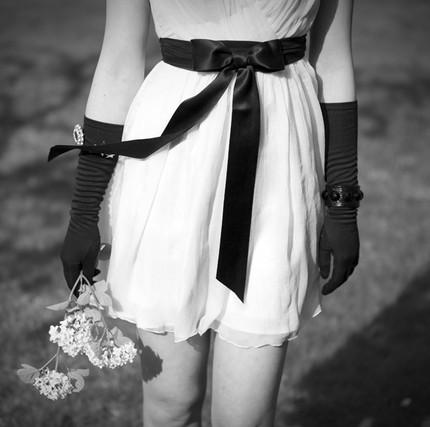 White-mini-wedding-reception-dress-black-sash-black-vintage-gloves.full