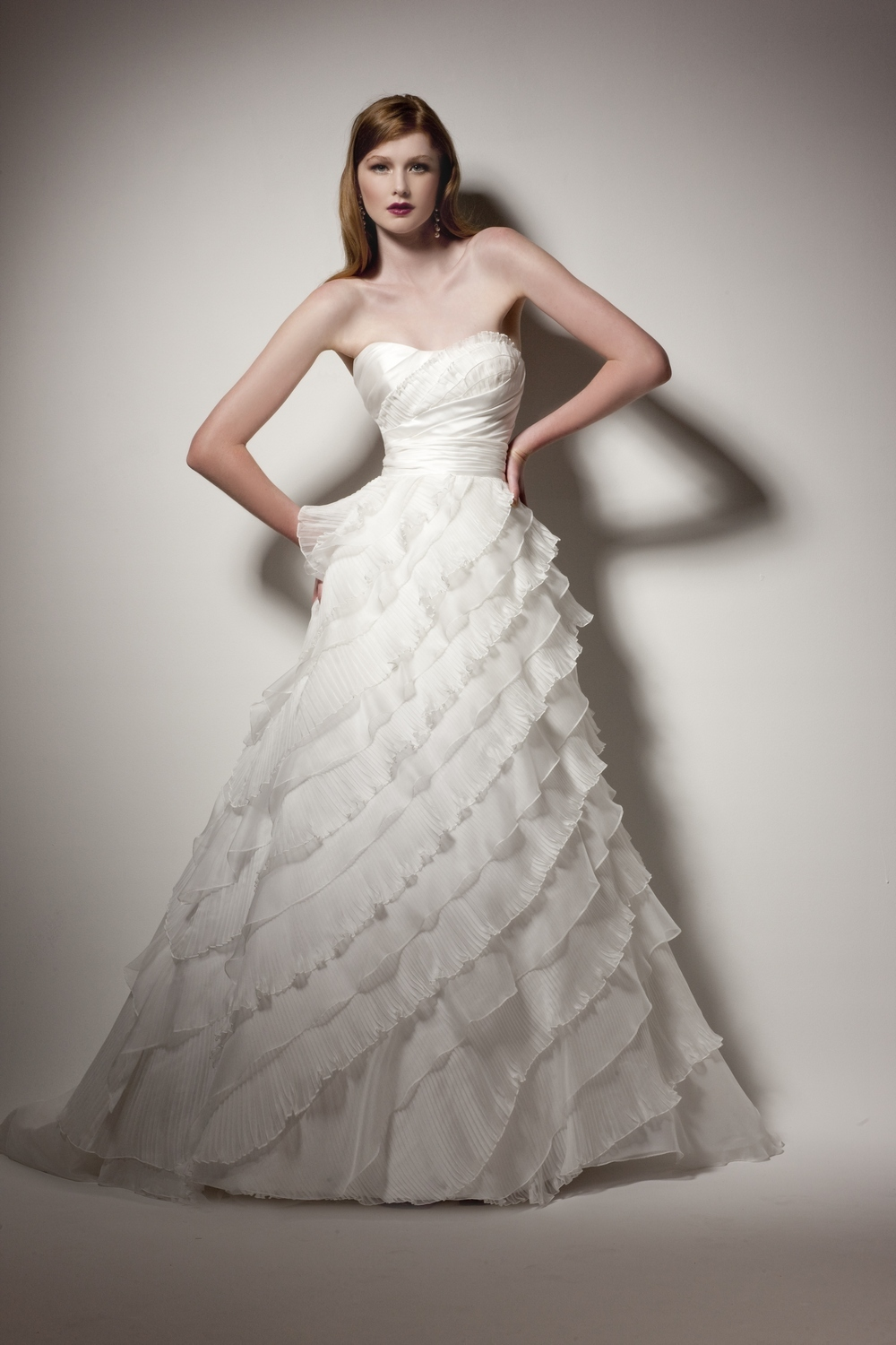This white strapless full a-line wedding dress is actually convertible!
