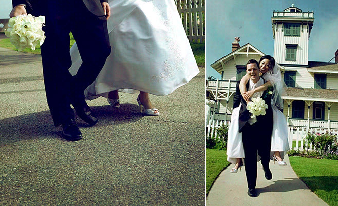 Groom holds bride's ivory calla lily bridal bouquet as they walk hand in hand; bride in white strapl