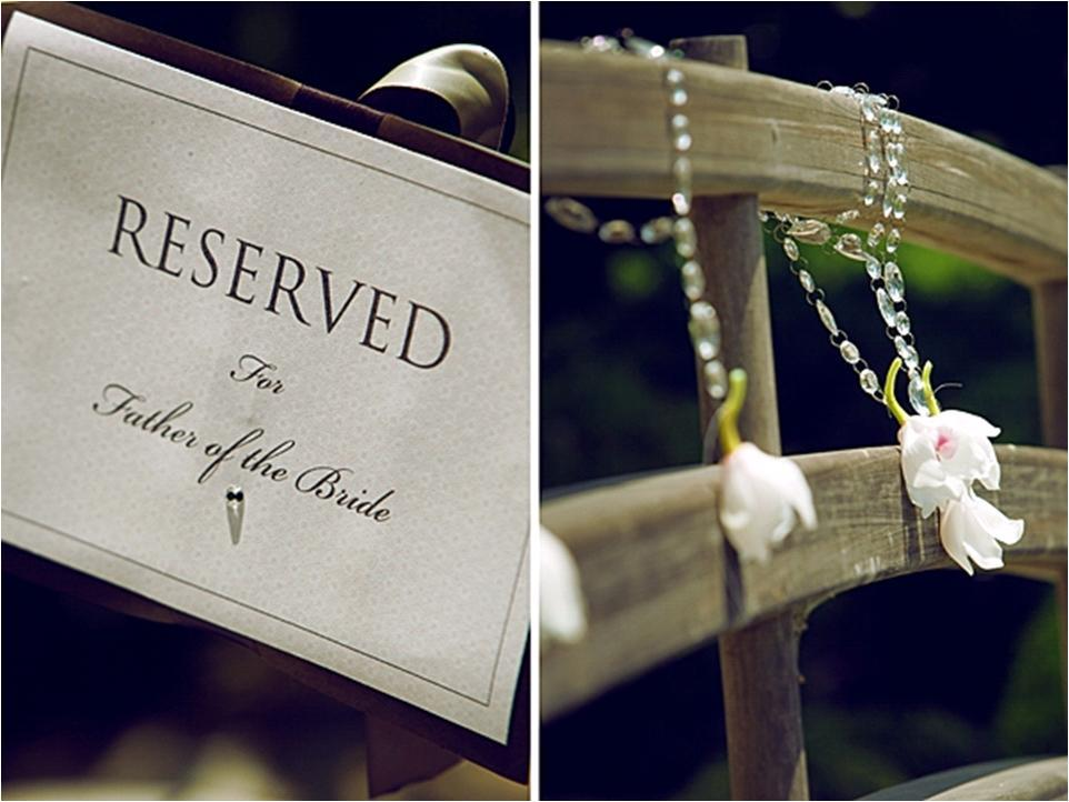 Chic modern white and black reserved chair sign for bride and groom at wedding reception; reception