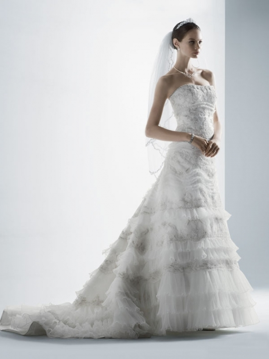 Classic ivory lace a-line wedding dress with tiered ruffles and intricate beading