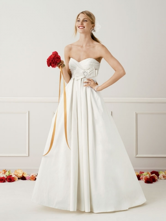 Full a-line princess ivory wedding dress with deep sweetheart neckline and lovely bow detail