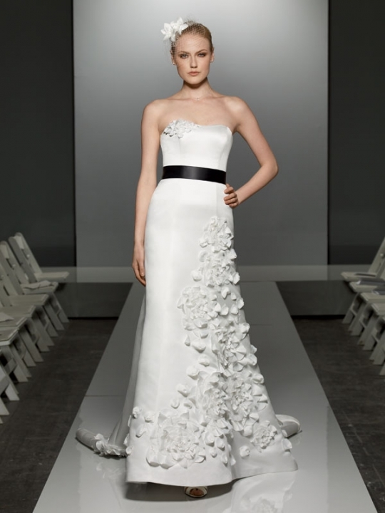 White strapless Galina mermaid wedding dress with cascading floral applique and black sash