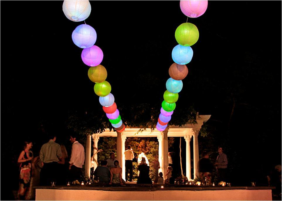 Nighttime-at-wedding-ceremony-and-reception-colored-lanterns-columns.full