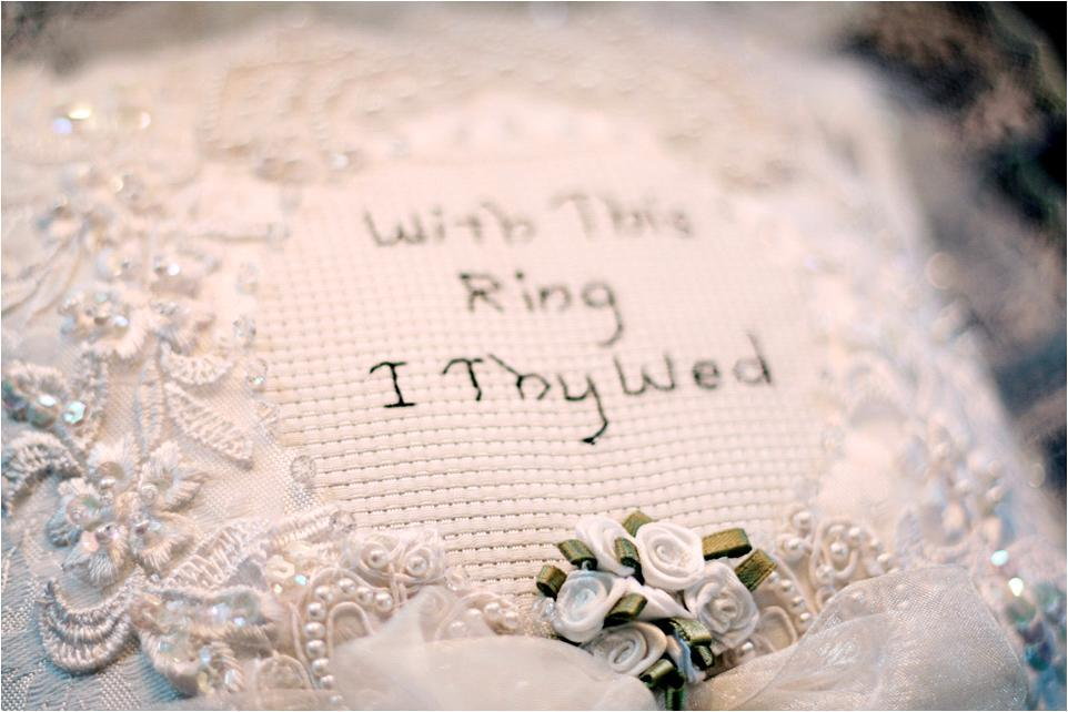 handmade ring bearer pillow that reads With This Ring I Thy Wed