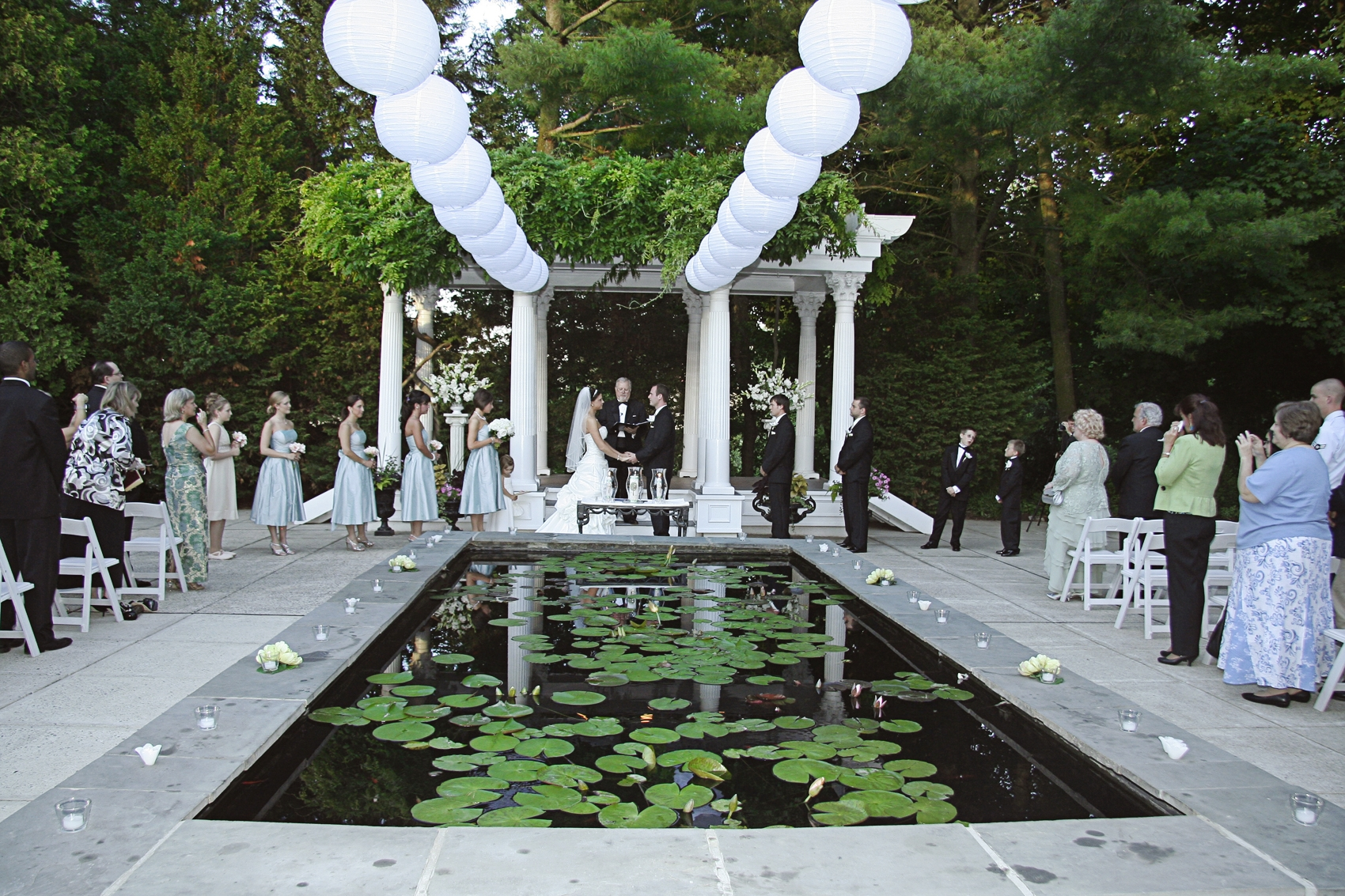 Outdoor Courtyard Ceremony Venue With Lily Pads And White Lanterns