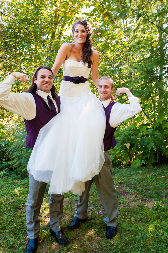 Groomsmen Lifting Up The Bride
