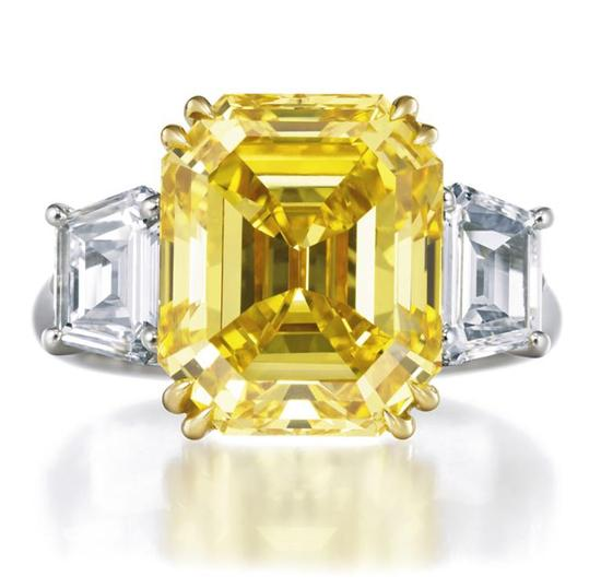 Brilliant emerald cut yellow diamond platinum engagement ring by Harry Winston