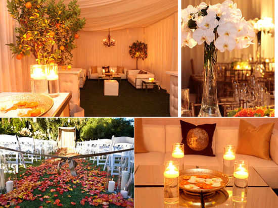 Orange and coral rose petals scattered down the wedding aisle; candlelit wedding reception tent