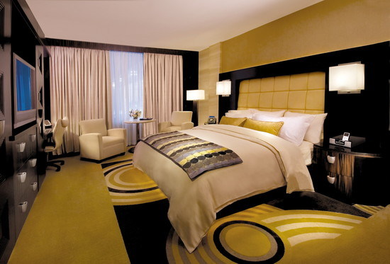 This gold and black hotel room with a king size bed is perfect for wedding guests.
