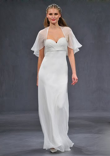 Light and airy white wedding dress with sweetheart neckline and sheath silhouette