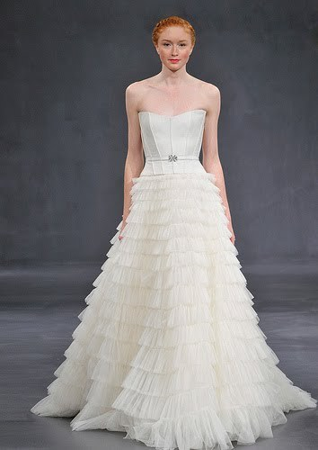 Full a-line ivory strapless wedding dress with corseted bodice and tiered skirt