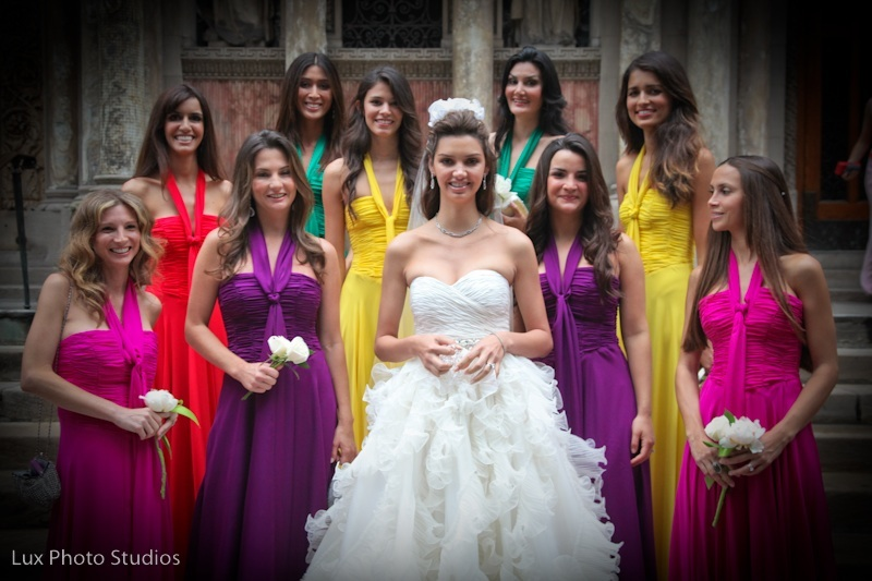 This bride has many bridesmaids all wearing different for Different colored wedding dresses