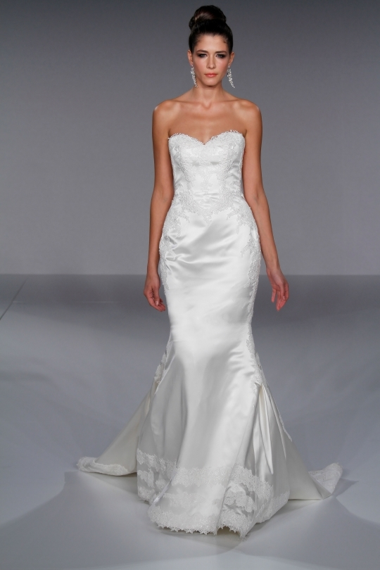 White satin fitted mermaid wedding dress with romantic lace touches