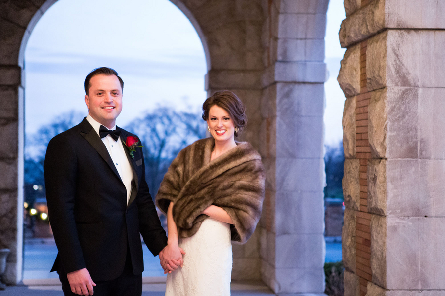 Gorgeous Bride in a Fur Coat with her Groom