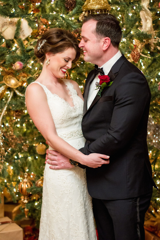 Sweet Bride and Groom In Front of a Christmas Tree