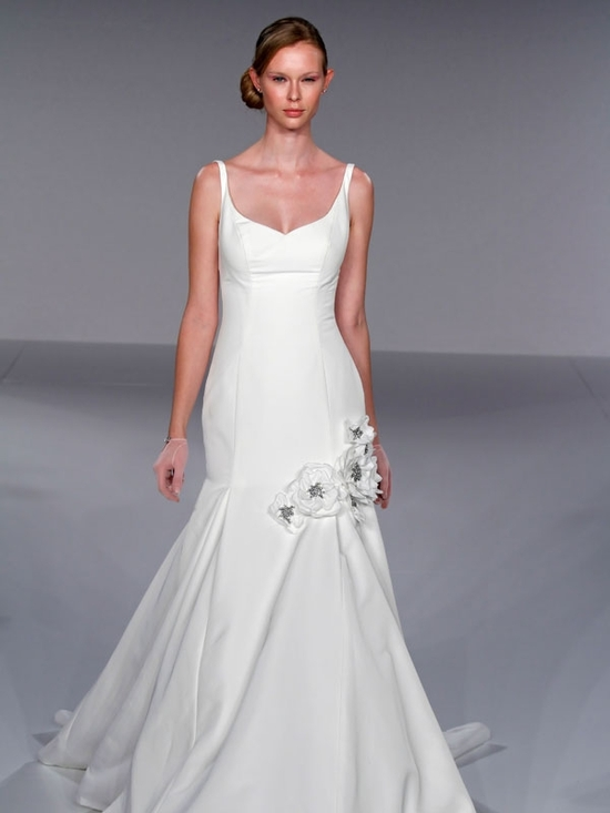 White simple and sophisticated v-neck mermaid wedding dress with flowers placed at low hip