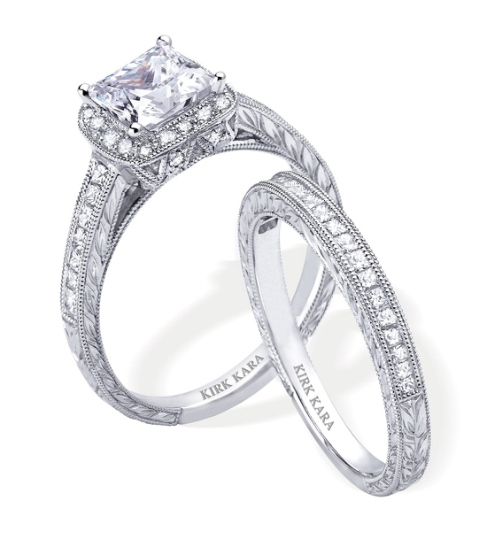 Dazzling platinum and diamond engagement ring and wedding band set by Kirk Kara