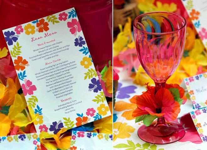 Luau-rehearsal-dinner-hibiscus-dinner-menu-pink-wine-glasses-adorned-with-flowers.full