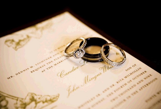 Diamond-cushion-cut-engagement-ring-and-wedding-band-photographed-on-ivory-and-olive-green-wedding-invitations.full
