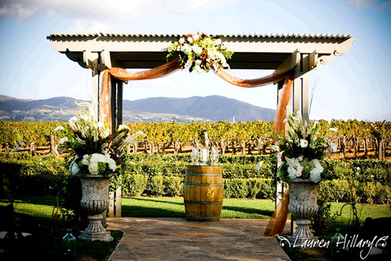 Gorgeous wedding arbor with picturesque Temecula, CA rolling hills in the background
