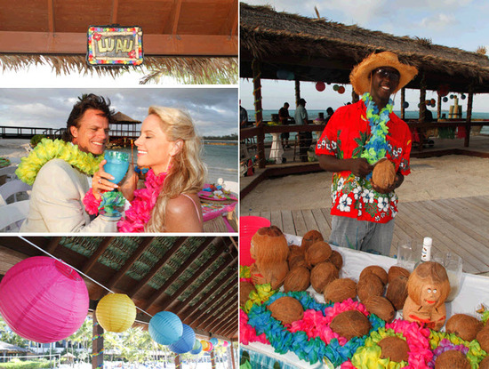 Wood Luah sign, colorful paper lanterns, and tropical leis decorate the beachside boardwalk