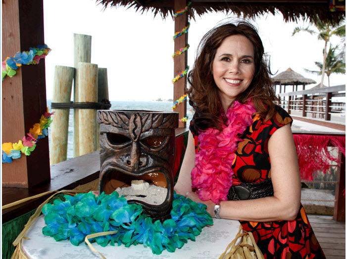Festive-luau-cocktail-hour-for-rehearsal-dinner-flaming-tiki-mask-leis-and-more.full
