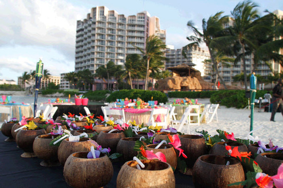 Wedding guests were greeted with tropical drinks served in coconut shells at the rehearsal dinner!