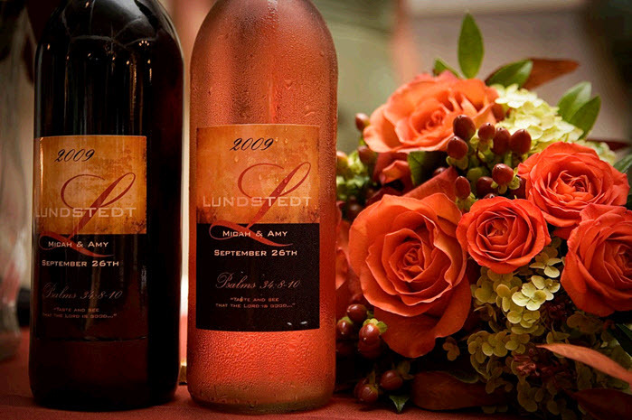 Personalized-wedding-reception-detail-personalized-wine-labels-with-couples-name-wedding-date-autumn-fall-wedding-flowers-orange-roses-cranberries.full