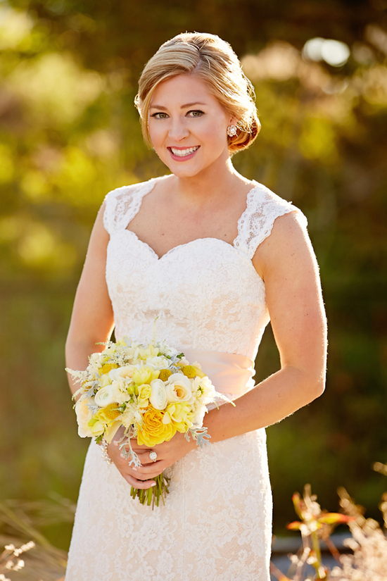 Lovely Bride in a Lace Gown and Yellow Bouquet