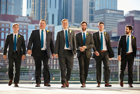 Groomsmen in Blue Ties and Black Suits