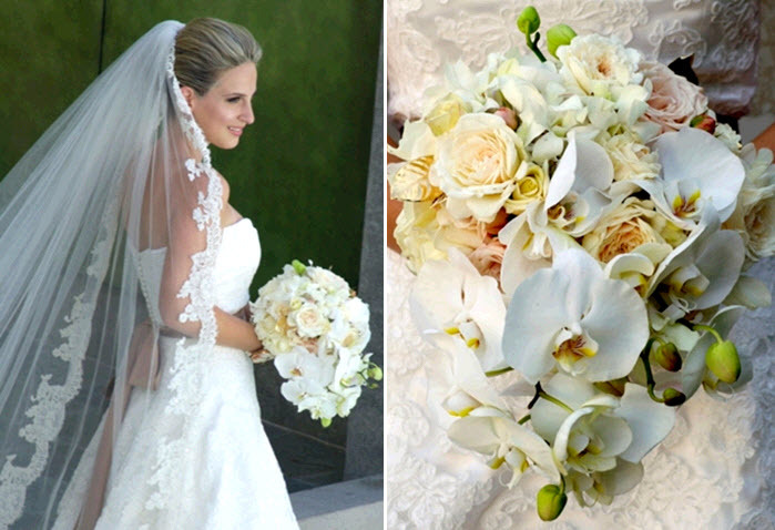Beautiful-bride-in-white-strapless-wedding-dress-mantilla-lace-veil-holds-white-orchids-roses-ivory-bridal-bouquet.full