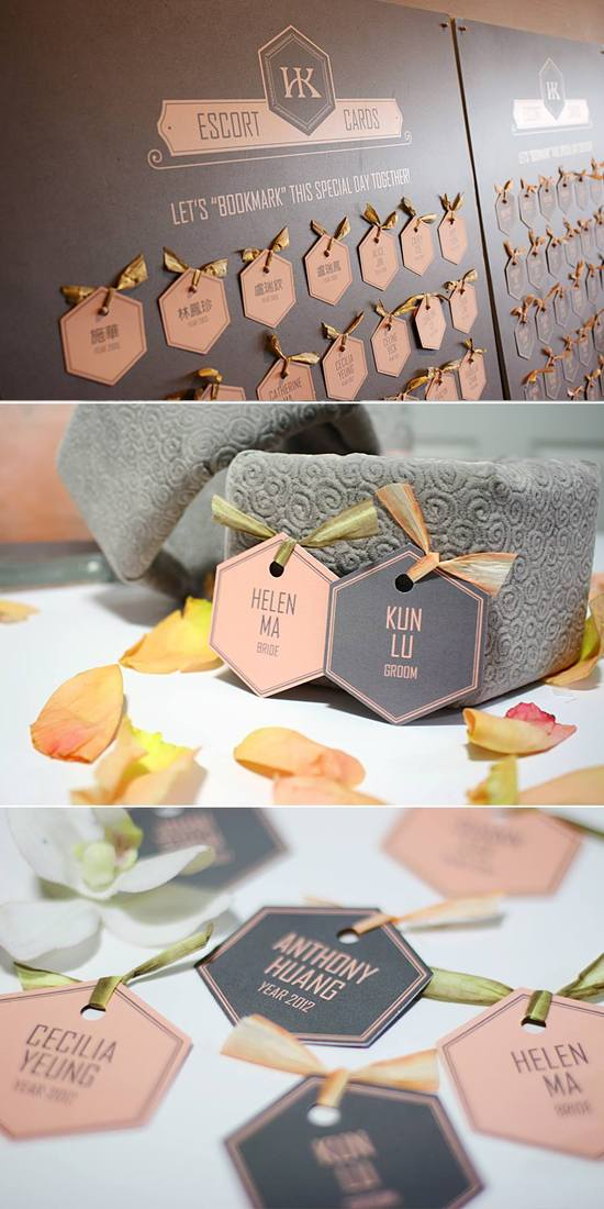 "Escort cards in peach and gray color were used as ""bookmarks"" for the guests to remember the special day"