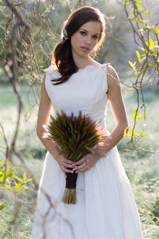 Bateau neck white wedding dress made from eyelet cotton