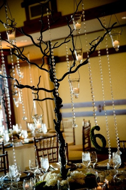This centerpiece consists of a tree with crystals and a moss table number