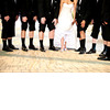 Fun-wedding-photo-groomsmen-show-off-black-tux-socks-shoes-bride-lifts-wedding-dress-to-show-off-bridal-heels.square