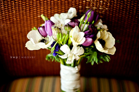 Bride's romantic bridal bouquet: ivory flowers, purple tulips, and green accents