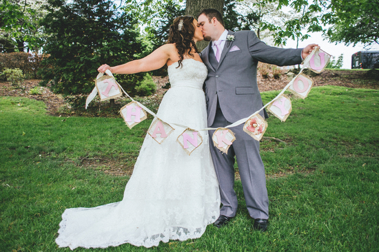 Bride and Groom with DIY Burlap Thank You Banner