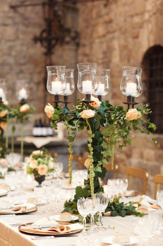 Romantic Candelabra Centerpiece Covered in Foliage