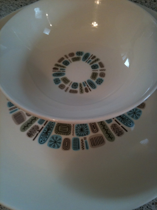 These dishes are off-white with a retro blue and green circular pattern in the middle
