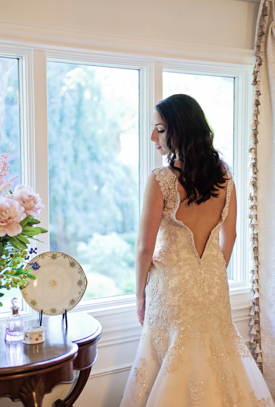 Off White Embroidered Wedding Gown with a Deep V Back