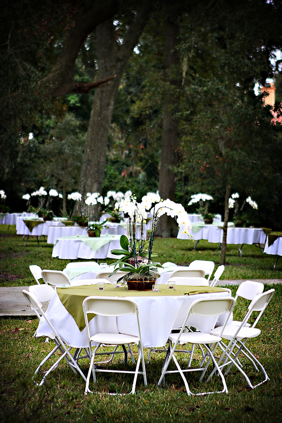 These outdoor tables are perfectly complimented by the white orchid centerpiece.