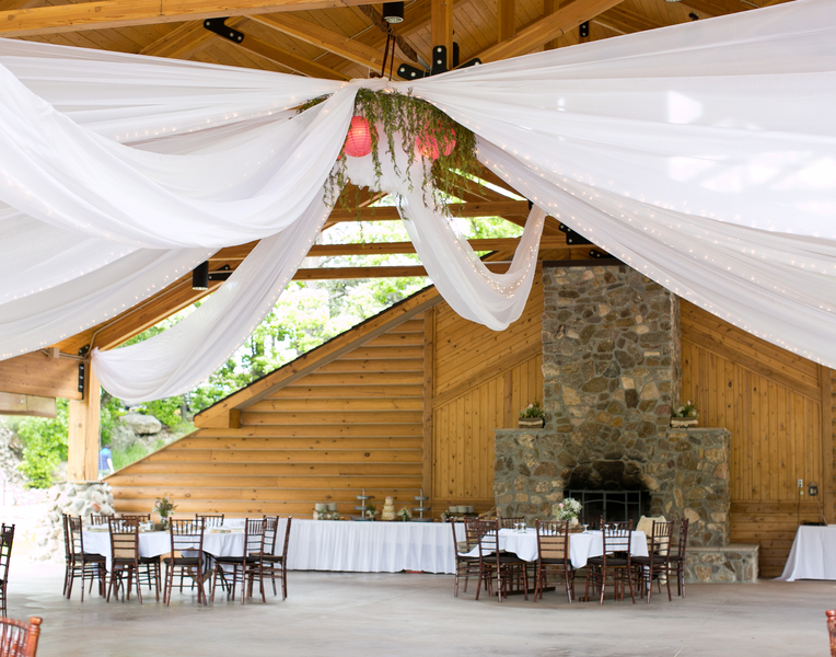 Outdoor Reception Venue with Draped Fabric and Twinkle Lights
