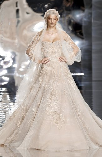 This stunning wedding dress from Ellie Saab features a low cut top with a bodice cut and a full skir