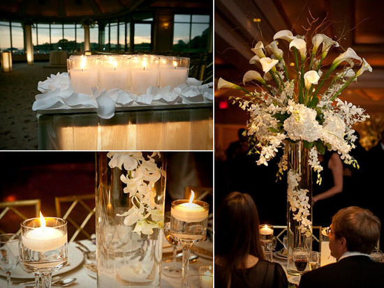 Romantic white candles decorate and light up wedding reception venue on the water