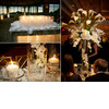 Romantic-candlelit-wedding-reception-on-the-water-white-candles-wedding-decor-tablescape-white-floral-centerpieces.square