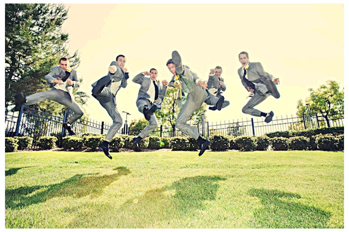 Casual-groomsmen-in-grey-suits-yellow-tie-jump-ninja-style-outside-at-california-quirky-wedding.full