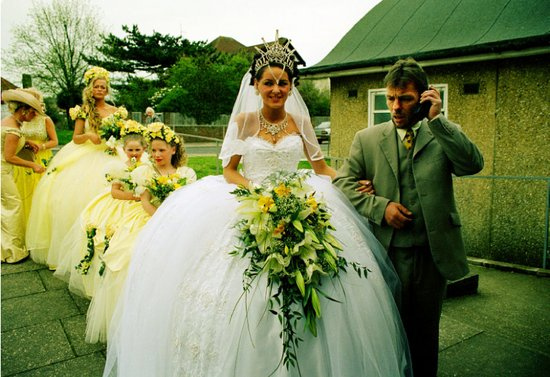 This woman is an Irish Traveler having an ornate wedding in an extravagant white wedding dress with